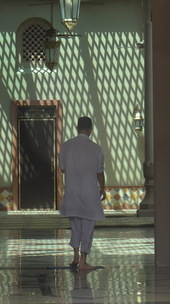 Man walking through mosque. Bandar Seri Begawan, Brunei